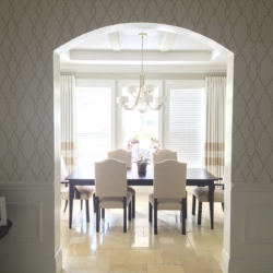 a peek into dining space with beautiful wallpaper
