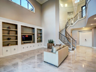builder home living space with custom cabinetry