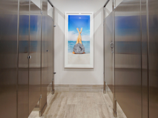 commercial bathroom with artwork