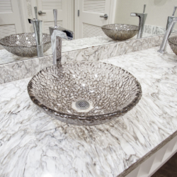 glass bowl sink with marble countertop