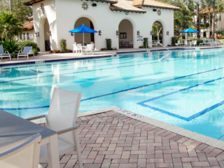 poolside table and chairs with umbrella commercial